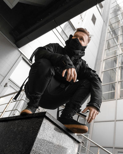 Urban Ninja, Urban, Urban Fashion, Fashion, ninja Real People Architecture Day One Person Low Angle View Full Length Young Adult Men Young Men Males  Adult Lifestyles Indoors  Sitting Clothing Built Structure Black Color Casual Clothing Contemplation