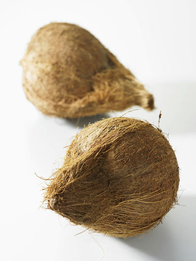 whole coconut Coconut Raw Brown Close-up Cut Out Dry Food Food And Drink Freshness Healthy Eating Indoors  Nature No People Nutrition Plant Produce Raw Food Still Life Studio Shot Wellbeing White Background Whole