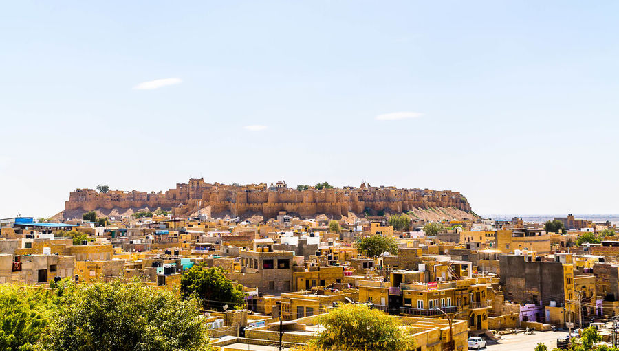 Jaisalmer Fort, Rajasthan, India Building Exterior Architecture Built Structure Building Sky Nature Outdoors City Aerial View Ancient Ancient Architecture Breathtaking View Cityscape Desert Fort Rajasthan Living Fort Historical Building Hilltop Landmark Tourist Attraction  Maharaja Rajput Sandstone Travel Destinations Urban Yellow
