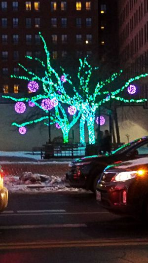 Festivity + progress ~ Car Night Illuminated No People Multi Colored Defocused Outdoors City Light And Dark My Point Of View Winter Colors Of Life Walking Around Town Holiday Decorations Trees Windows Tradition Holiday Spirit Electricity  A Night Out AI Now In Portland Maine USA
