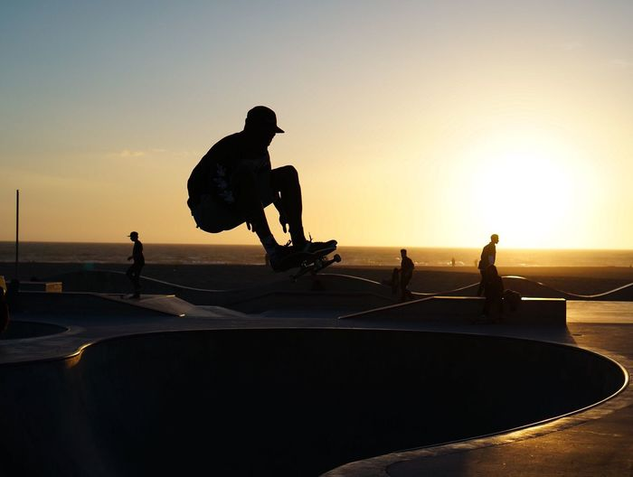 Sunset Silhouette Skateboard Park Lifestyles Sport Outdoors Beach City