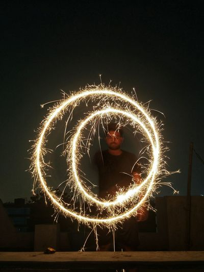 Man Spinning Sparkler At Night