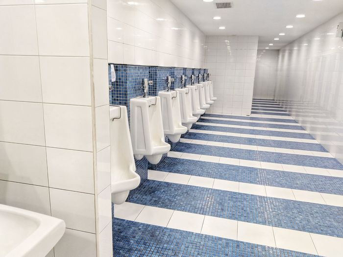 Architecture Built Structure Building Office Building Residential Structure Urinal Fire Escape Residential  Building Exterior Locker Room Passageway Stairway Historic Residential Building Spiral Staircase Public Restroom Exterior Tiled Wall Tile Urinating Wall - Building Feature Settlement Whitewashed Locker