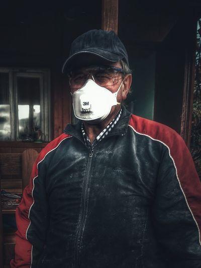 Portrait of man wearing gas mask
