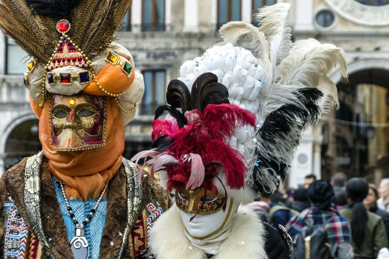People wearing costume and masks during event