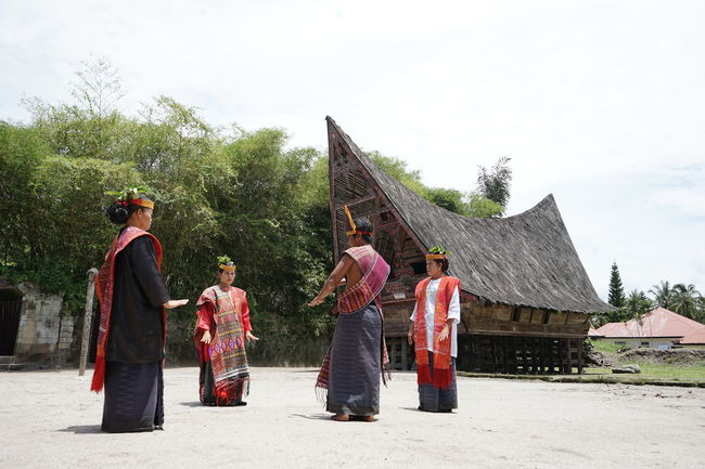 Batak Dance Adult Architecture Built Structure Clothing Day Full Length Group Of People Men Nature Outdoors People Plant Real People Religion Sky Traditional Clothing Tree Uniform Women