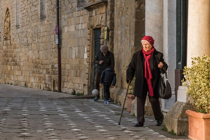 Adult Center Church Historic Italy Medieval Medieval Architecture Old Old Lady People Renaissance Renaissance Architecture Stone Street Streetphotography Tourism Tower Town Travel Destinations Tuscany Volterra Walking Wall Woman