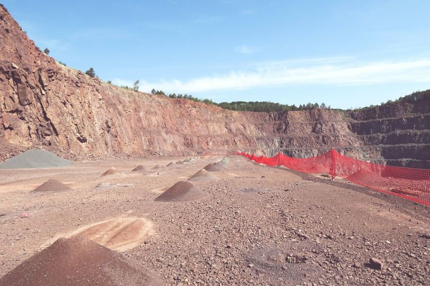 view into a quarry mine. safety net on abyss Safety First! Rock Porphyry Mining Industry Rock Formation Surface Mine Mining Heritage Surface Mining Mining Pit QuarryRock Quarry Rock Quarry Mining Mine Open Pit Mine Open Pit Mining Safety Net