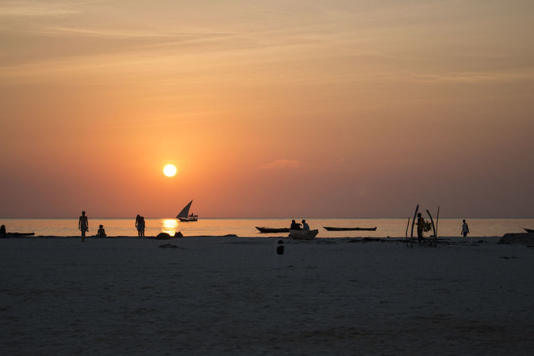 Dawn over the fishermen EyeEmNewHere Ocean View Shape Beach Dawn Fisherman Horizon Horizon Over Water Nature Nautical Vessel Ocean Outdoors Real People Sailboat Scenics - Nature Sea Shadow Ships Silhouette Sky Sunset Tranquil Scene Tranquility Water
