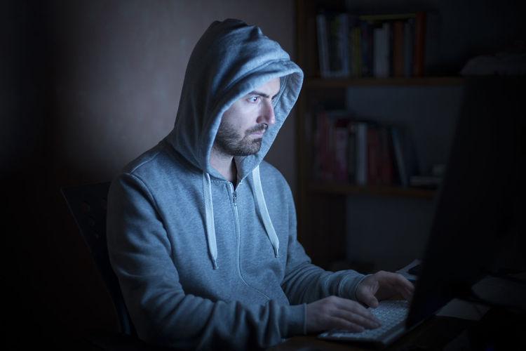 Portrait of man using computer