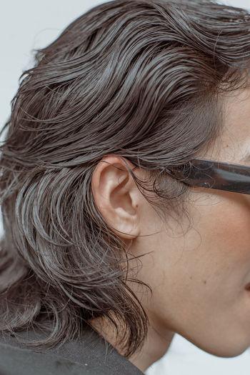 a wavy sea Glasses Hair Hair Salon Hairstyles Beauty Salon Brown Hair Close-up Ear Hair Hair Care Hair Style Haircut Hairdresser Hairstyle Hairstylist Healthy Hair Human Ear Human Face Human Hair Skin Care Skincare Wet Hair
