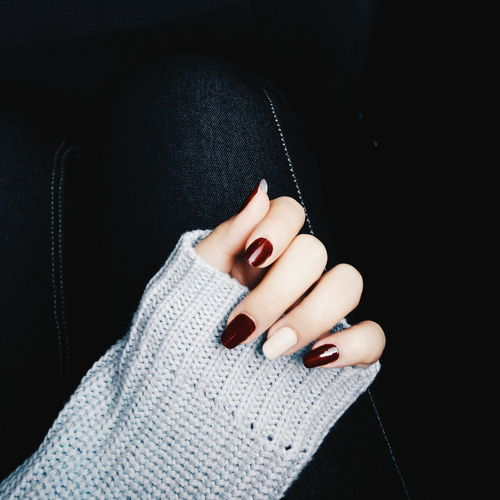 Cropped Hand With Nail Polish On Fingernails