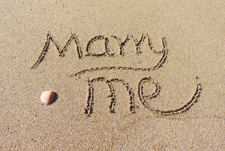 Engagement scene on the beach, sand writing or me, holiday marriage. Engagement Marry Me? Writing Beach Capital Letter Communication Creativity Day Drawing Engagement Photography Handwriting  Land Marriage  Marry Me Message Nature No People Outdoors Positive Emotion Sand Sand & Sea Sand Drawing Sand Writing Text Western Script