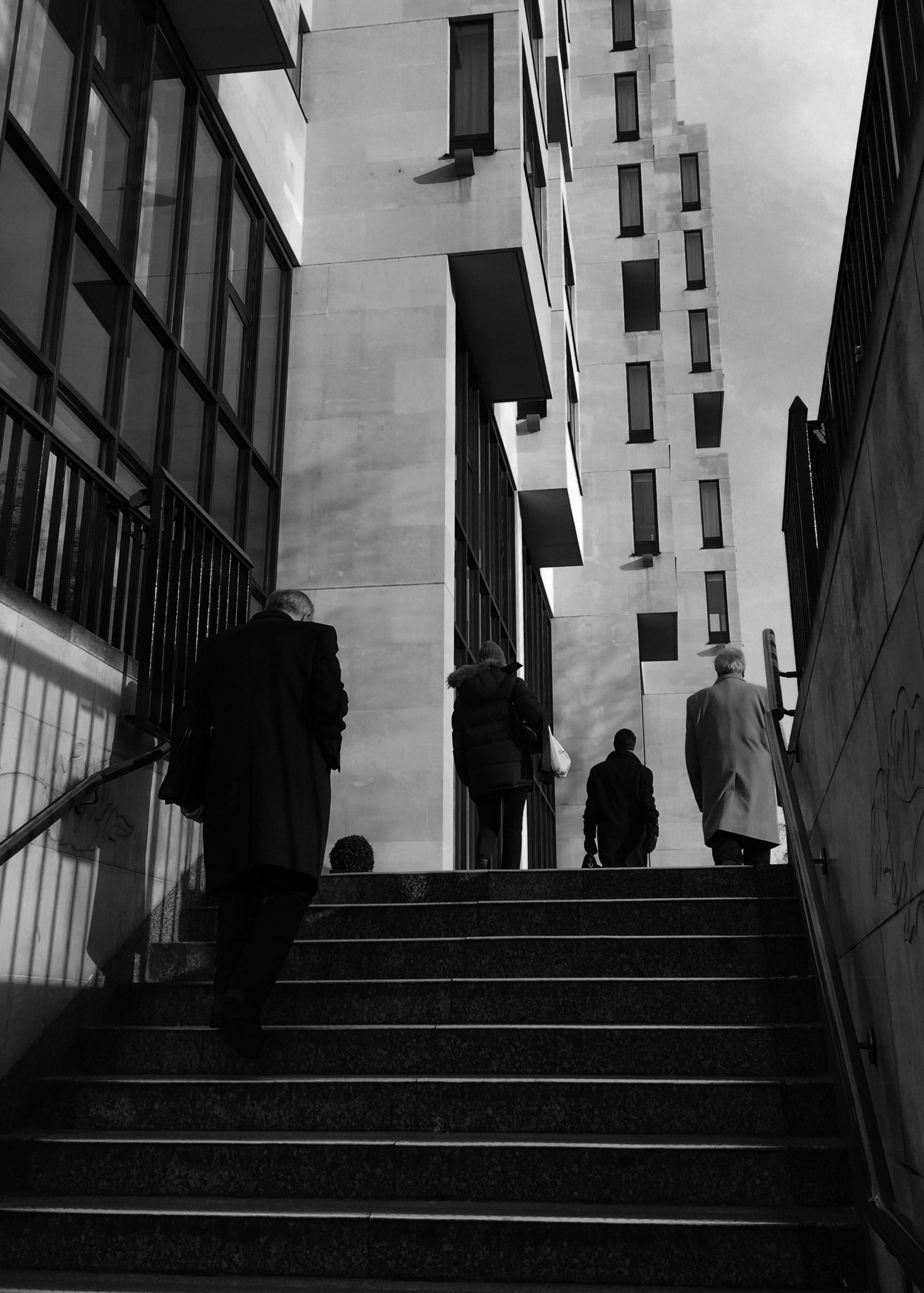 architecture, built structure, building exterior, steps, steps and staircases, staircase, railing, low angle view, men, walking, sky, building, stairs, lifestyles, silhouette, city, person, full length