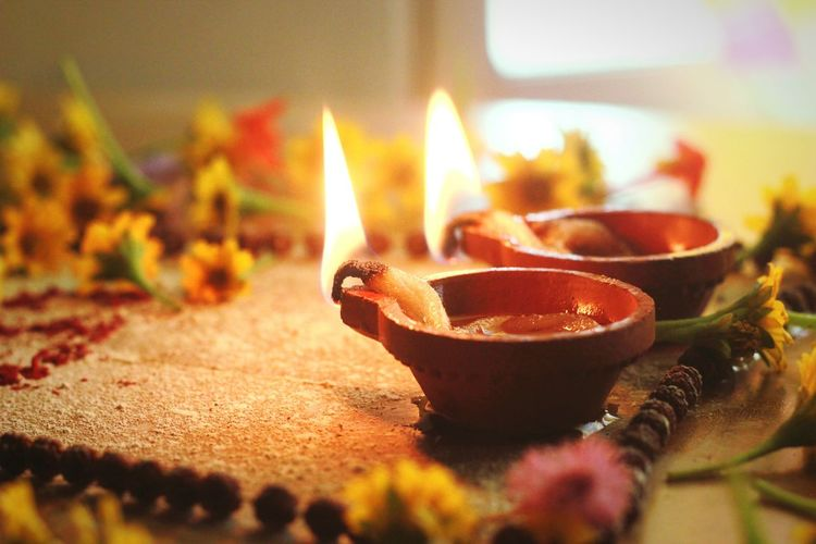Burning Heat - Temperature Diya - Oil Lamp Horizontal Diwali Day Close-up Oil Lamp Flame No People Outdoors God's Beauty Devotional Flower Flower Head Peaceful View