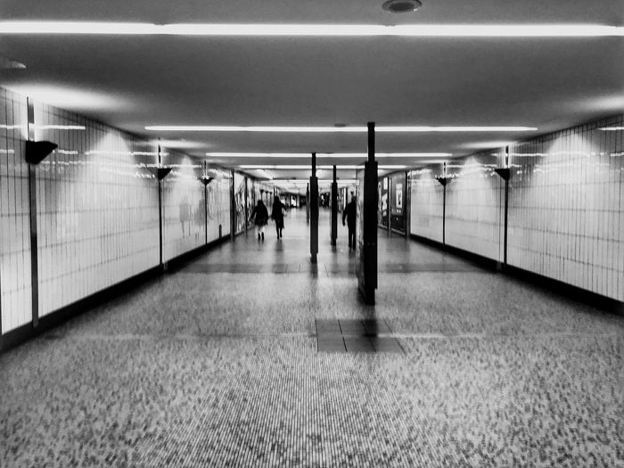 Subway Architecture The Way Forward Illuminated Flooring Transportation Ceiling Built Structure Indoors  Direction Subway Group Of People Corridor Public Transportation Arcade Real People Lifestyles Diminishing Perspective Women Incidental People Adult