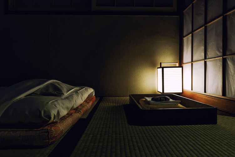 Japanese Culture Absence Architecture Bed Bedroom Dark Domestic Room Flooring Furniture Home Interior Hotel Illuminated Indoors  Lifestyles No People Pillow Relaxation Ryokan Sheet Table Technology Window