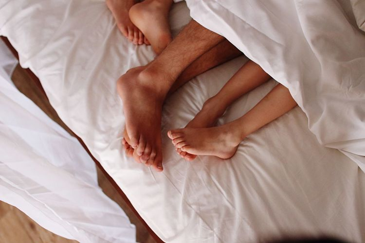 Bed Bedroom Sheet Indoors  Lying Down Blanket Pillow Real People High Angle View Relaxation Heterosexual Couple Comfortable Women Men Sleeping Human Body Part Lifestyles Two People Home Interior Couple - Relationship