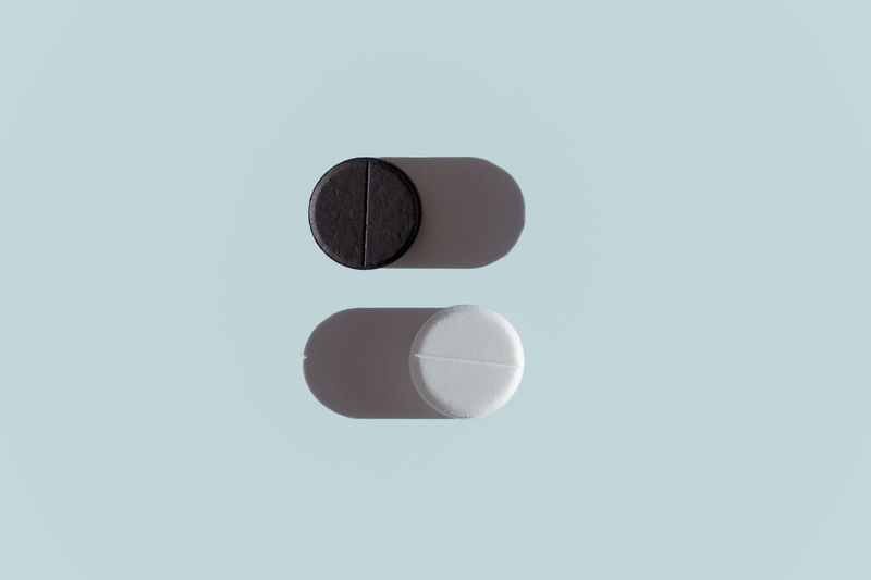 Black and white pill with shadow. like buttons or switches