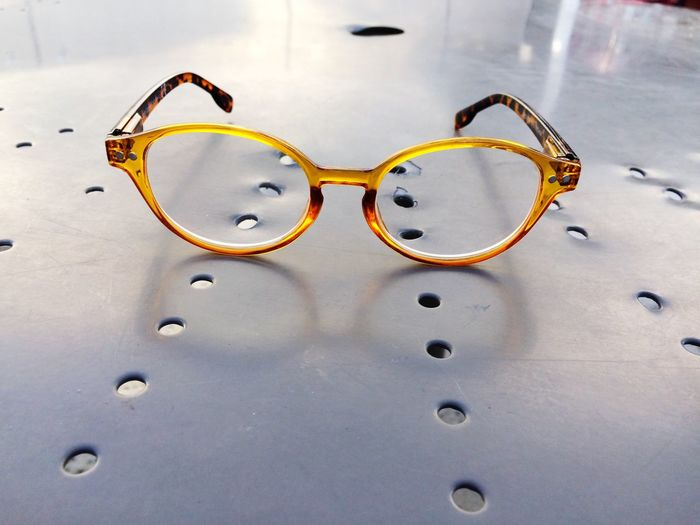 You can see clearly now. Yellow Glasses Eye Glasses JGLowe Glasses EyeEm Selects No People Eyesight Close-up Indoors  Eyewear Day