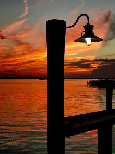 Sunset Sea Orange Color Water Lighting Equipment Sky Nature Street Light No People Beauty In Nature Illuminated Scenics Silhouette Tranquility Outdoors Nautical Vessel Horizon Over Water Harbor EyeEm Vision OceanCity Light And Shadow Wineandmore EyeEm Best Shots Jeff Woytovich EyeEm Gallery