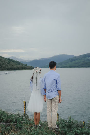 wedding Rear View Water Two People Mountain Sky Couple - Relationship Real People Women Togetherness Men Nature Scenics - Nature Love Adult Beauty In Nature Lifestyles Young Adult Young Men Positive Emotion Outdoors Wedding Wedding Photography