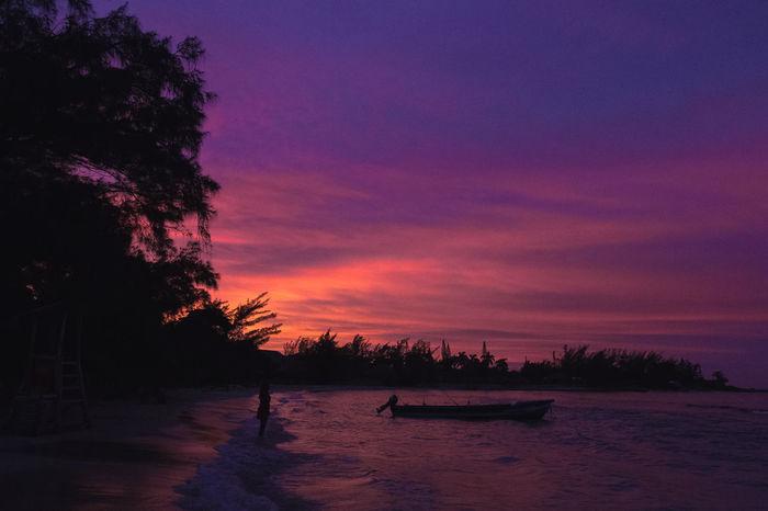 Lost In The Landscape Ocho Rios Jamaica Orange Pink Silhouette Beach Beauty In Nature Boat Jamaica Nature Outdoors Purple Sea Silhouette Sky Sunset Tranquil Scene Tree Treeline Silhouette Water