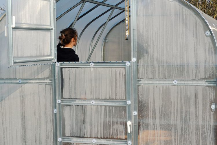 Greenhouse Young Women Women Rear View Looking Through Window Thinking Building Head And Shoulders Pretty Window Exterior