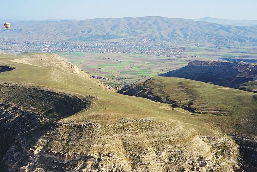 Hot air balloon over the valley Balloon Hot Air Balloon Fairy Chimneys Knycl Turkey Kapadokya Cappadocia Valley Land Tranquil Scene Tranquility Nature Scenics - Nature Day Beauty In Nature Landscape Sky High Angle View Sunlight Non-urban Scene No People Idyllic Outdoors