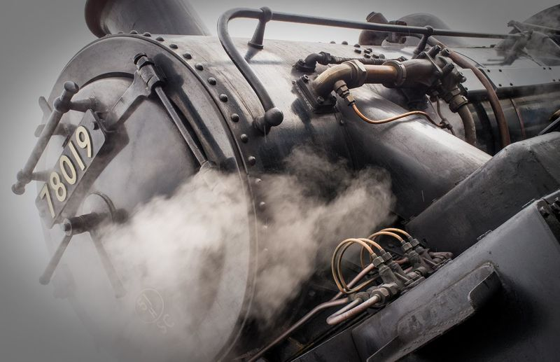 Low angle view of steam train