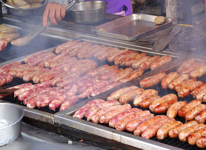 A market stall sells grilled sausages hot off the griddle Chinese Food Hot Off The Griddle Smoke Barbecue Fire Food And Drink Grilled Sausage Meat Nice Smell Outdoors Pork Sausage Ready-to-eat Sausage Street Food