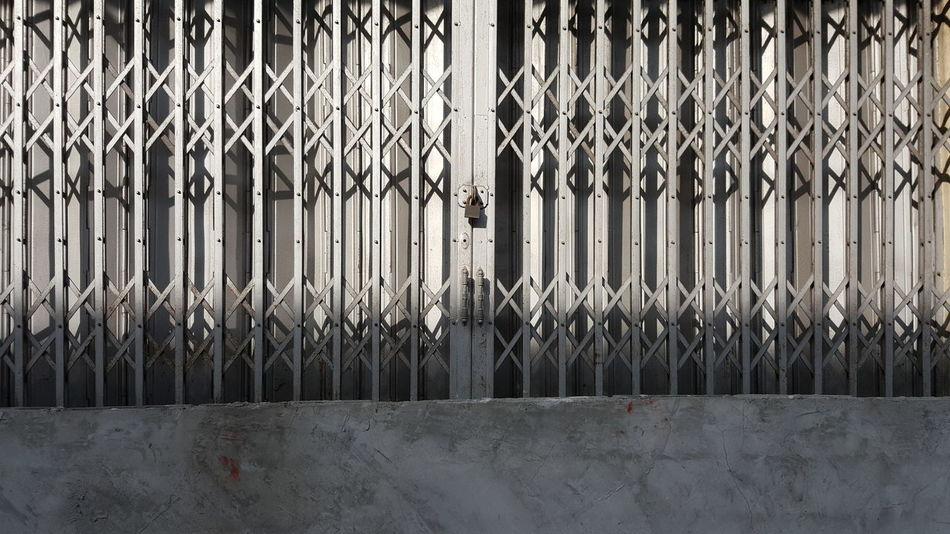 Backgrounds Textured  Full Frame No People Sunlight Close-up Shadow Day Outdoors Steel Structure  Door Steel Door Architecture Interior Design Exterior Exterior Building LINE Pattern Barrier Curb Closed Closed Door Shophouse Boundary