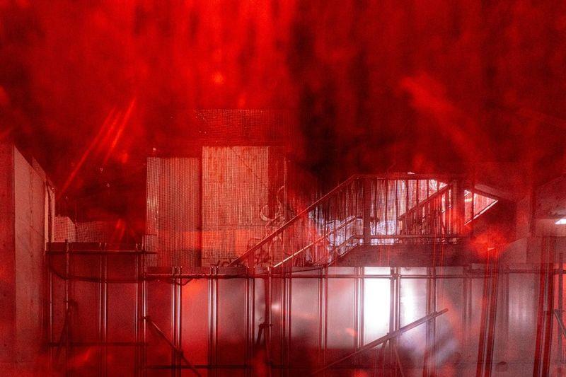 Digital composite image of illuminated window in building