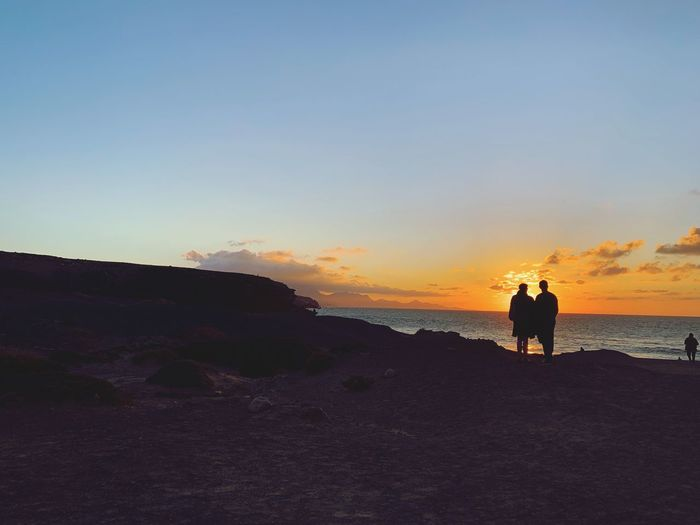 Couple Sky Sunset Real People Beauty In Nature Water Beach Land Leisure Activity Togetherness Nature Scenics - Nature Men Adult Women Tranquility People Two People Lifestyles Sea Positive Emotion