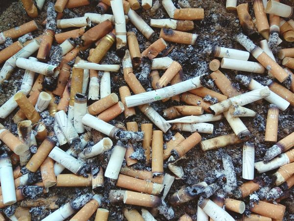 EyeEm Selects Large Group Of Objects Abundance Bad Habit Addiction Danger Backgrounds Full Frame Smoking Issues Cigarette Butt RISK Social Issues Excess No People Heap Close-up Indoors  Ashtray  Day