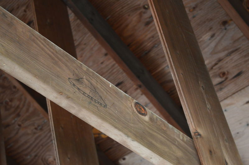 Low angle view of ufo drawing on wooden plank