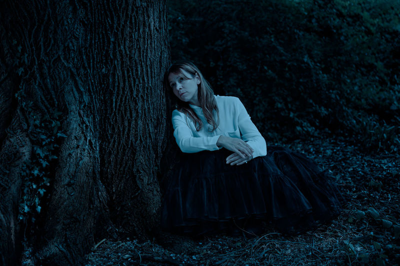 Sitting Thinking Contemplation Depression - Sadness Forest Full Length Hair Leaning Leaning Against Tree Leisure Activity Long Hair Nature Night One Person Outdoors Plant Sad Serious Tree WoodLand Young Women