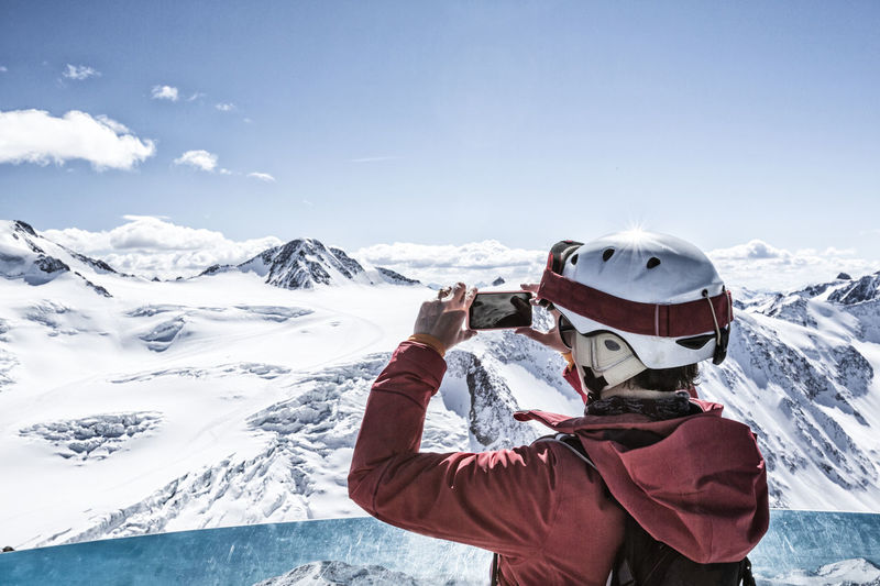 Skier takes a photo at the viewpoint App Camera Moment Panorama Adventure Alps Beauty In Nature Experience Glacier Ischgl Lifestyles One Person Picture Pitztal Scenics Ski Ski Holiday Ski Resort  Smartphone Snow Sölden Take A Break Take A Photo Viewpoint Winter