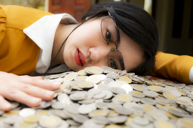 Business woman Hand Protecting With Stacked lots Coins, Portrait of beautiful happy young lady hands Pick up money on wooden table with white background, planning Investment and saving concept Women White Lady Female Butiful Weary Wealth Treasure Tired Thailand ASIA Success Stack Savings Savings Money Save Rich Protection Protecting Poverty Payment Money Market Management Lots Investment Hand Glade Fortune Exchange Employees Economy Earning Dollar Desk Currency Counting Counting Money Coins Coin Bath Coin Bank Accountant Cashier  Business Thai Baht Thai Baht Coins Thai Baht Note Baht Thai