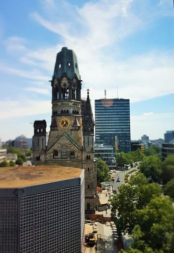 City Life Kaiser-Wilhelm-Gedächtnis Kirche Architecture Building Building Exterior Built Structure City Cloud - Sky Day History Nature No People Outdoors Plant Religion Sky Sunlight The Past Tower Travel Travel Destinations Tree