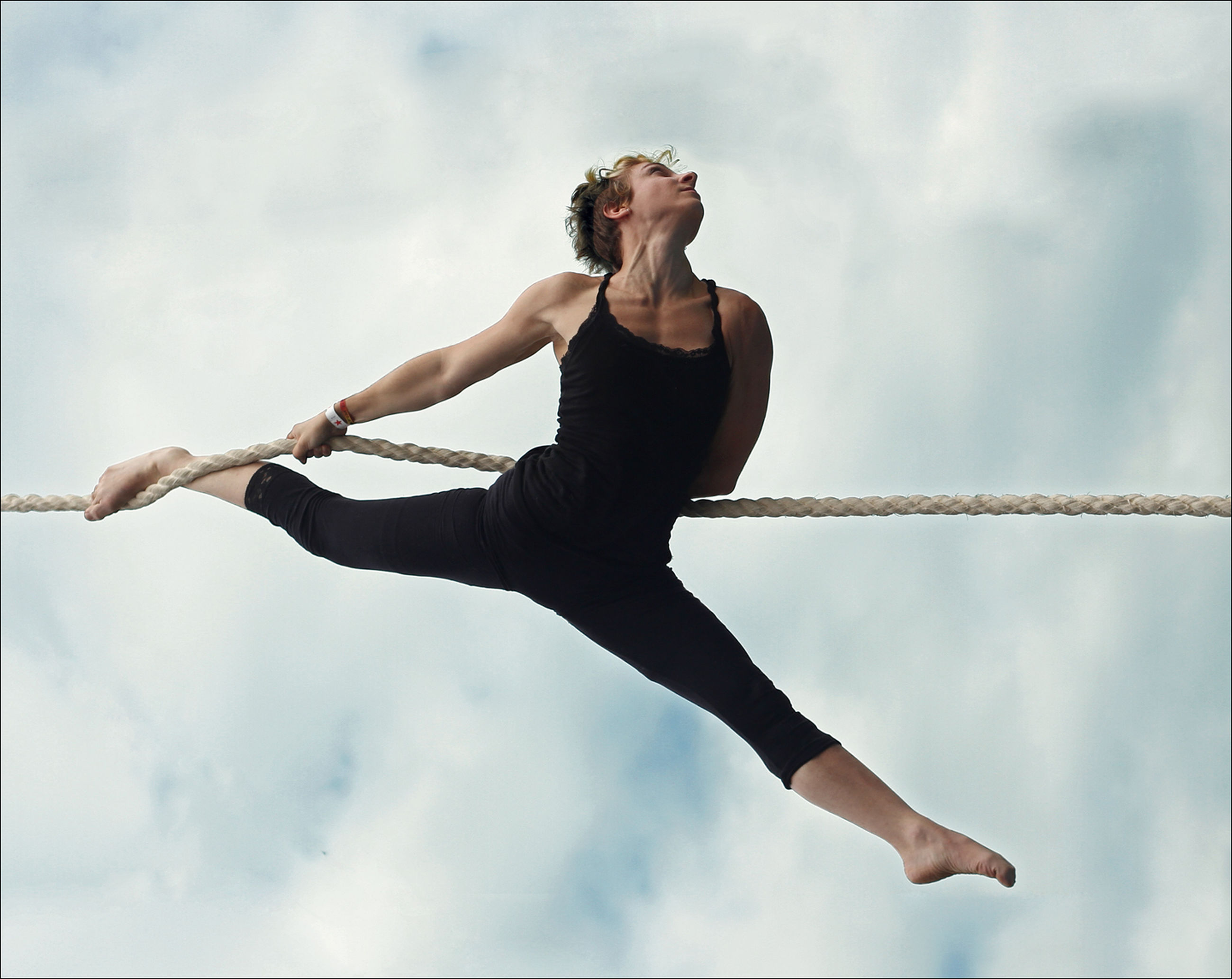 one person, cloud - sky, sky, full length, lifestyles, performance, young adult, skill, flexibility, exercising, dancing, adult, real people, low angle view, balance, practicing, day, nature, beautiful woman