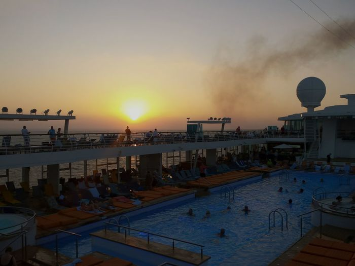 Sunset Travel Destinations Outdoors Sea Sky Sunset Silhouettes Swimmpool On Cruise Ship Mein Schiff 3 Swimmingpool Swimmingpool At Sunset Sunbeds Railings Abendstimmung Am Meer Evening Mood At The Sea Evening Glow Evening Sky Ladyphotographerofthemonth 3XSPUnity Beliebte Fotos Cruise Ship Sunset Cruiseliner Cruiseships On A Cruise Ship On A Cruise Miles Away Place Of Heart
