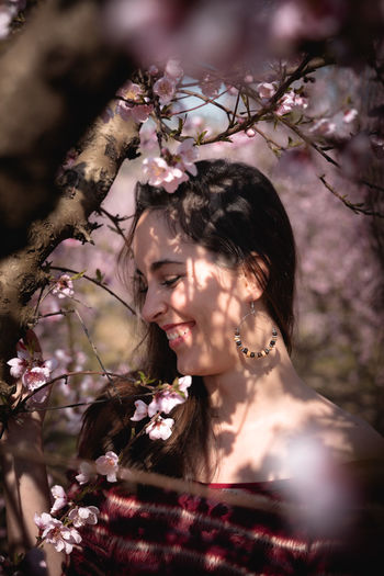 Portrait of woman with cherry blossoms