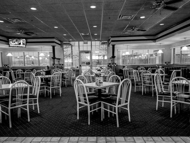 Large Group Of Objects No People Indoors  Day Culvers Saint Cloud, MN Minnesota Restaurant Fast Food Fast Food Restaurant Chairs Tables Dining Out Dining Area Snow Day Snowy Weather Checkered Pattern News On TV White Black & White Empty Clean Fans Lights Flowers