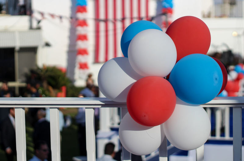 Close-up of balloons decoration on railing during independence day