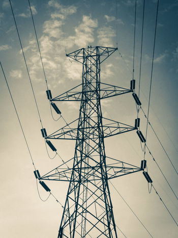 A cool-looking high-voltage pylon Cable Connection Electricity  Electricity Pylon Fuel And Power Generation High Voltage High-voltage Low Angle View No People Power Line  Tall Technology Tower