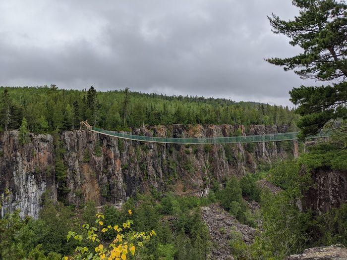 Panoramic shot of bridge on land against sky