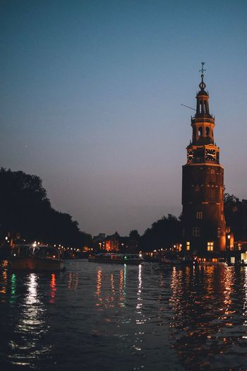 EyeEm Best Shots EyeEmNewHere EyeEm Selects EyeEm Gallery Building Exterior Architecture Sky Water Built Structure Illuminated Waterfront Building Reflection Tower Nature Night No People Clear Sky City Travel Destinations Copy Space Dusk Outdoors Amsterdam