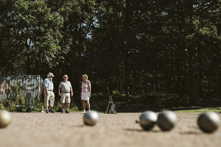 People playing with ball in background