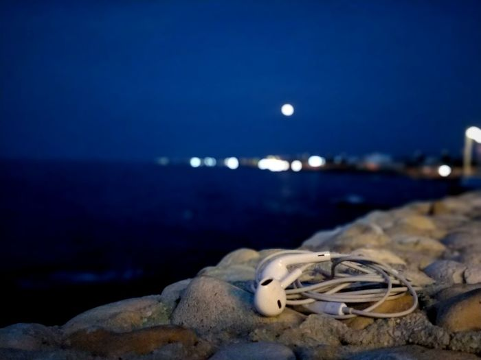 A little bit of a blood moon. Headphones Rock Stone The Great Outdoors - 2018 EyeEm Awards Lifestyles EyeEmNewHere Enjoying Life Life The Street Photographer - 2018 EyeEm Awards Stone Wall Wall Light Light And Shadow Bloodmoon The Traveler - 2018 EyeEm Awards Water Astronomy Clear Sky Sea Moon Beach Blue Sand Sunset Star - Space Full Moon Eclipse Moonlight Seascape Coast